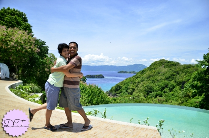 My parents with the infinity pool and view of the islands as their backdrop :P